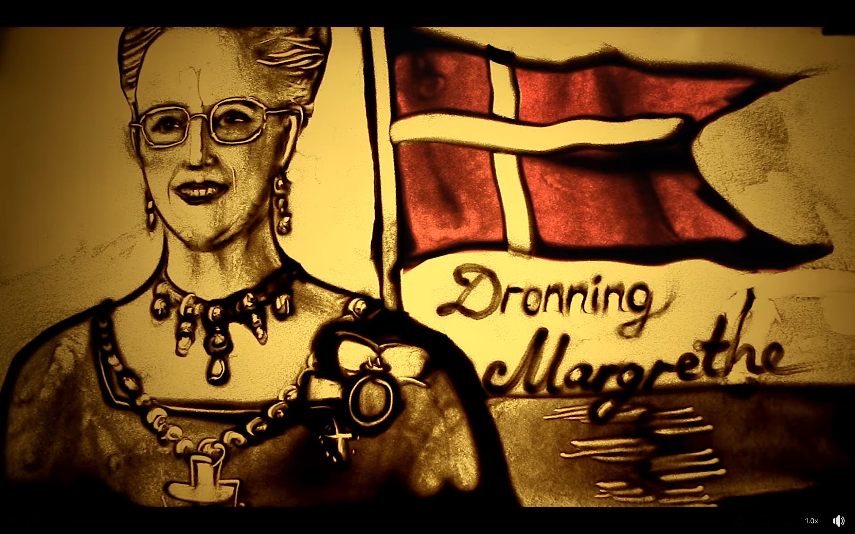 Se videoen: Musikkens Hus lykønskede Dronningen med vild sandkunst