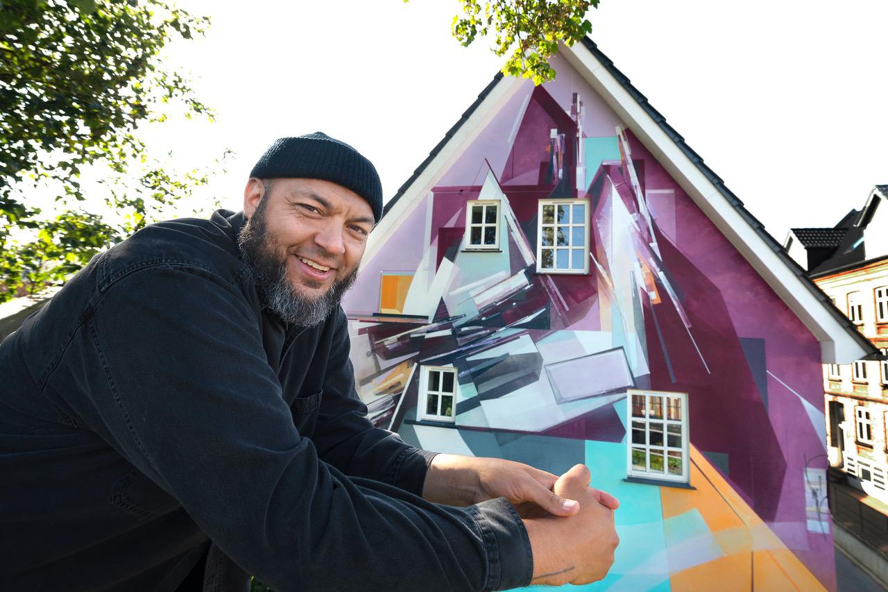 Endnu mere street art: Nyt gavlmaleri står færdigt i Aalborg